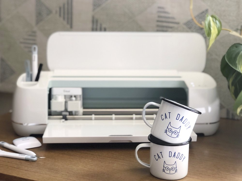 10 Things We Wish We Knew About The Cricut Maker - DIY Vinyl Enamel Cat Daddy Mug #cricut #cricutmaker #catsofinstagram #cricutexploreair2 #vinyl #enamelmug #tinmug # Cricut Maker #Cricut EasyPress #How to start in Design Space #Cricut Design Space #Using Maker for the first time #Opening Maker box #Starting with Cricut #Starting with Maker #How to use Cricut Everyday Iron on #How to use Cricut Premium Vinyl #New to Cricut
