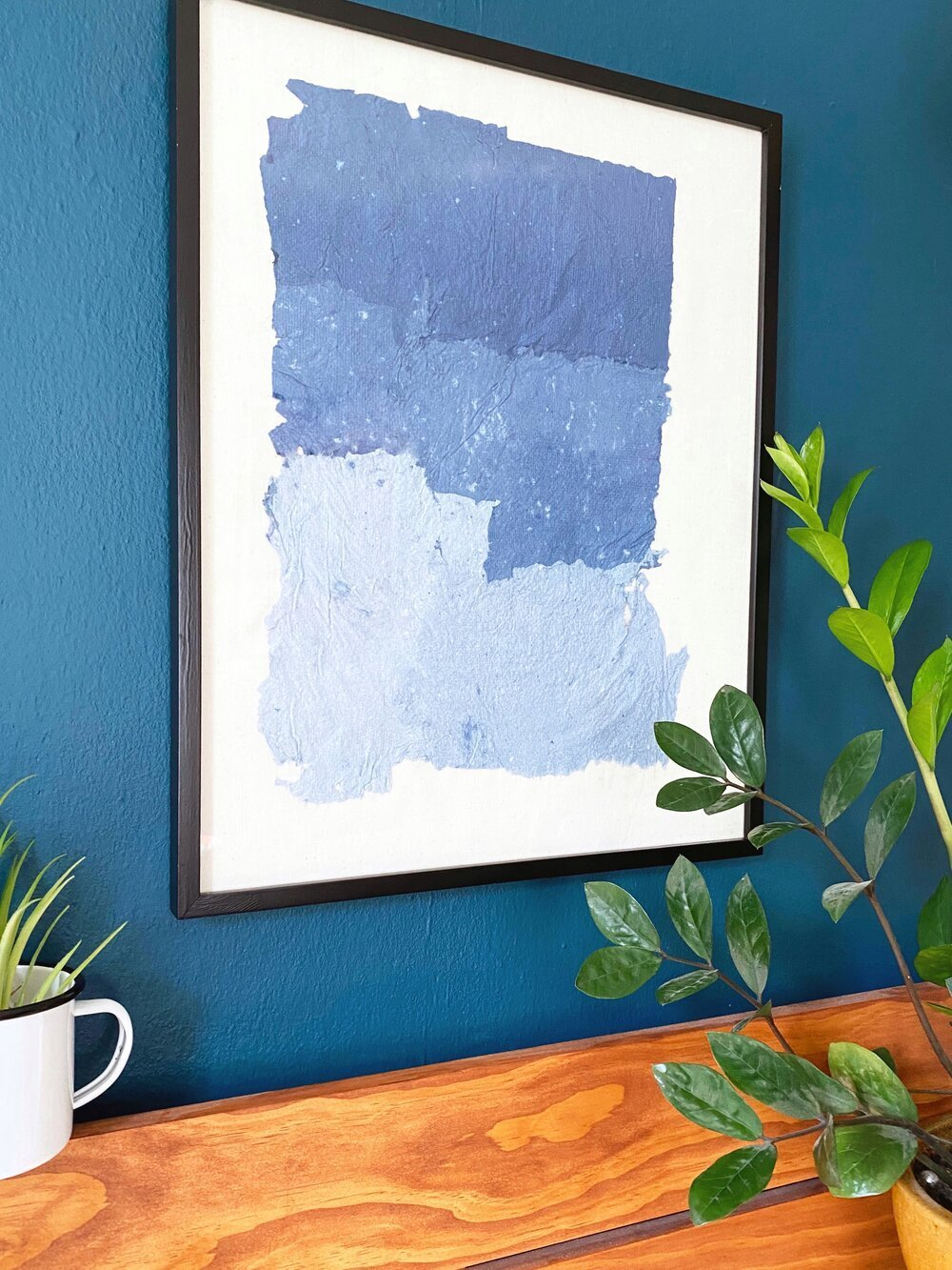Collect all your paper scraps and create a work of art! #wallart #papermaking #howtomakepaper #apartmentliving #smallspaces #hgtv #hgtvhandmade #easycrafts #art #colorblocking #upcycle