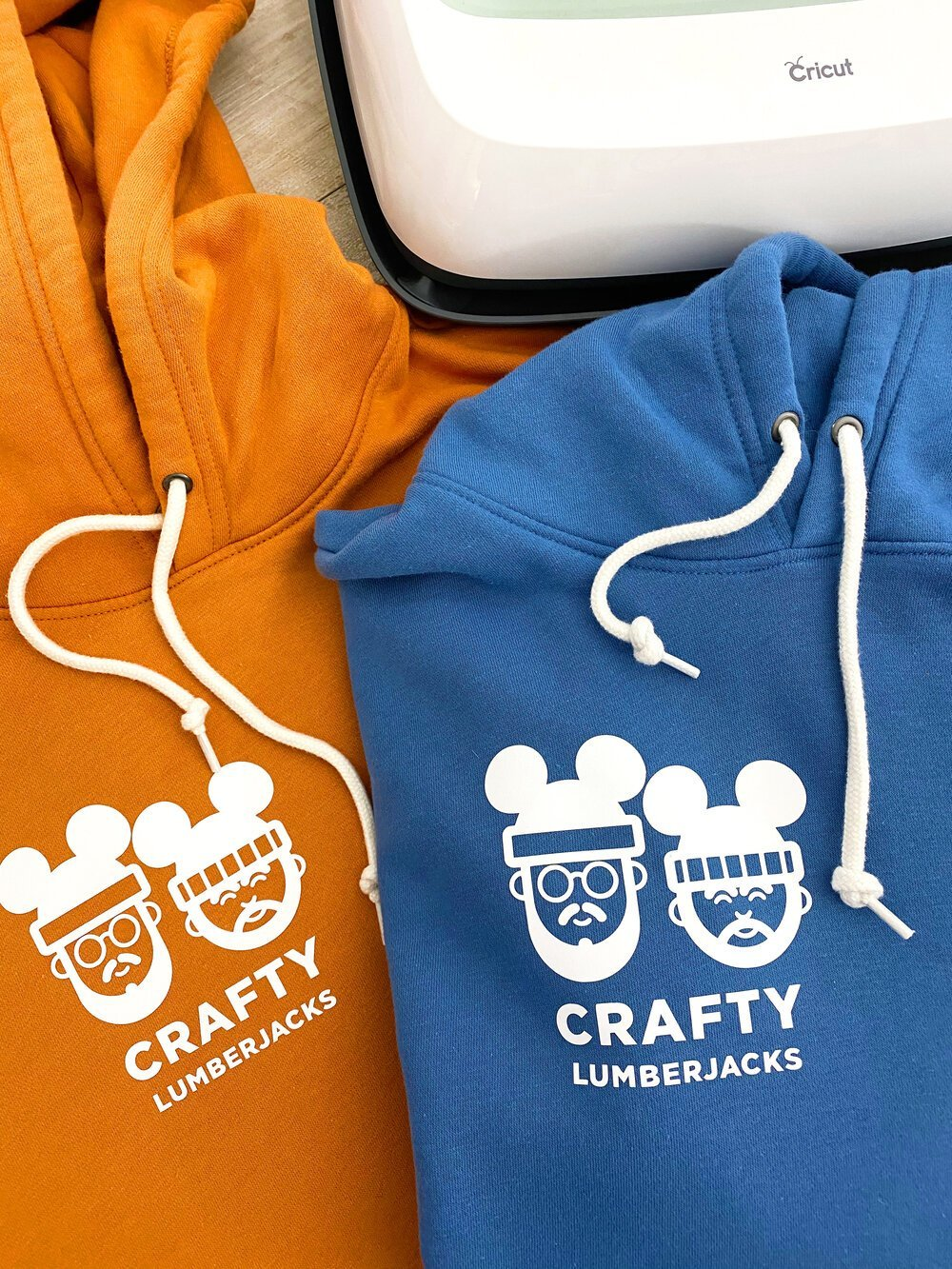 Create your own Disney magic by giving your logo or any image Mickey ears! How to Iron-on using the Cricut Maker. #cricutcreated #cricut #disneyvacation #disneyshirts #mickeyears #disneyworld #disneyland #irononvinyl #easypress #customeshirts #disneyideas #disneyoutfits #gaycouple #disneyfreaks #cricutmaker