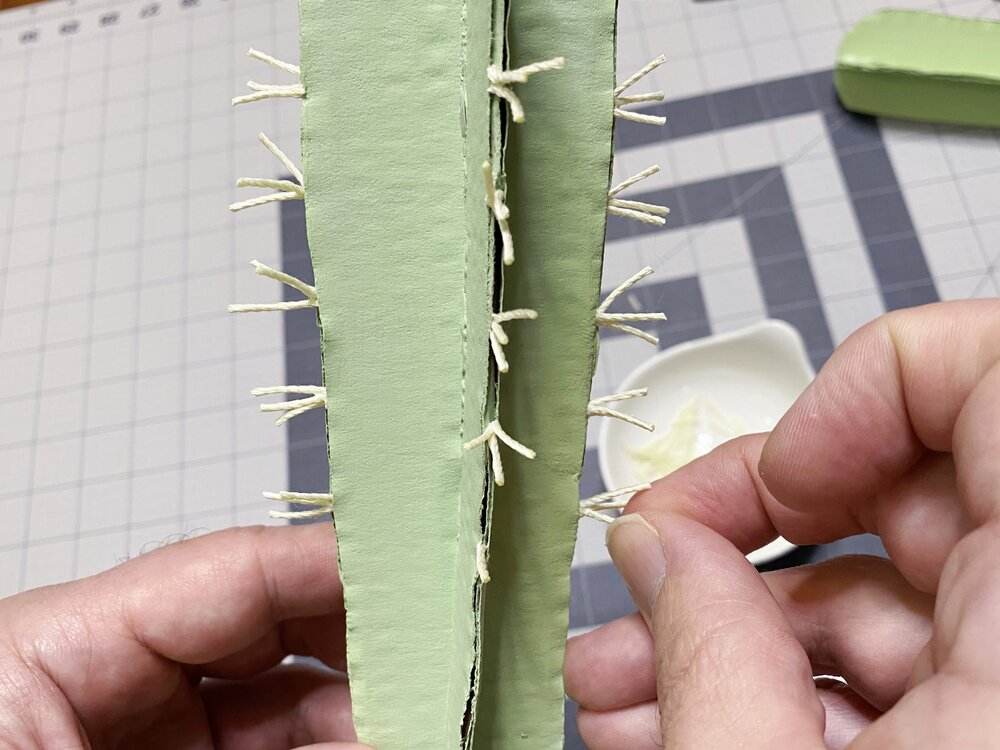 DIY Cardboard Cactus Houseplant With Free Template - Bored at home? Use what you have to make a modern cactus houseplant out of cardboard! #cardboardcrafts #houseplantdiy #cactus #diyapartmentdecor #apartmentinspirations #apartmenttherapy #quarantinecrafts #craftstomakewhenbored #greenthumb #plantcraft #hgtv #homedecor #urbanliving #quarantineactivities #bored #selfisolation #coronavirus #covid-19 #homerenovation #rainydayactivity #thingstodowhenbored #smallspaces #quarantinediys