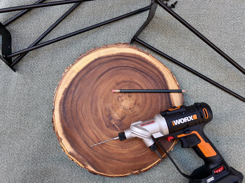 Turn a cutting board into a midcentury modern side table in less than 10 minutes! #cuttingboard #woodslice #hairpinlegs #hairpinlegtable #midcenturymodern #midcentury #worx #switchdriver #furniture #easy #diy #furniturehack #quick #drill #drillprojects #quickproject #rustic #cabin #woodcrafts #woodideas #nightstand #targethack #targetidea #hairpin #stool #woodstool #woodslicestool #homedecor #homedecordiy #upcycle