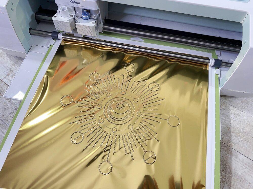 Everything you need to know about Cricut Foil Transfer System Kit. #cricutcreated #cricutfoil #cricutmaker #cricutexplore #cricutair #cricut #madewithcricut #madebycricut #cricutfoiltransfer #cricutfoiltransferkit #foiling #foil #gold #goldleaf #moonprint #sunrise #sunup #phasesofthemoon #witchvibes #witch #seasonofthewitch #cricuttutorial #cricutideas #cricutholiday #cricutchristmas #cricutgifts #cricutinvitation #invitation #cricuting #foilingsystem #foildiy #diy #howto #howtofoil #silverfoil #goldfoil #jewels #jeweltones #candlediy #fauxleather #vegancrafts #vegancraft
