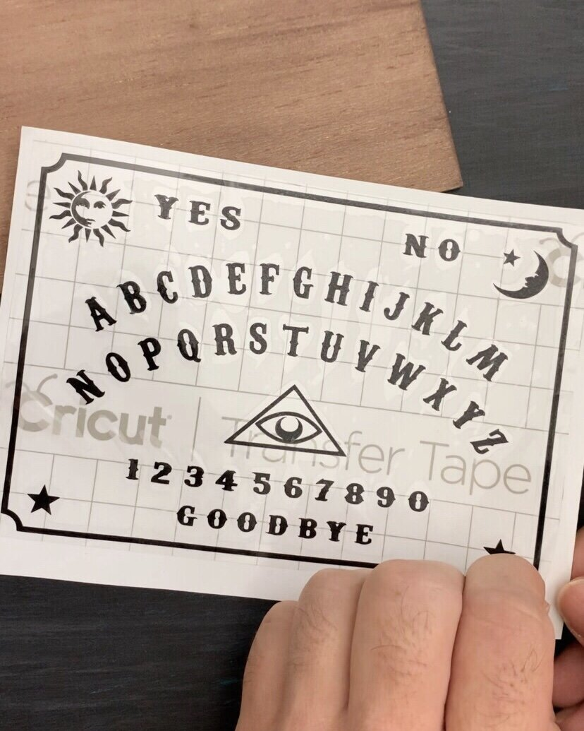 DIY Ouija Board using the Cricut Maker - Download the free SVG to make your own!  #HalloweenTree #treetopia #HalloweenOrnaments #FortuneTellerDecor #VintagePsychicDecoration #TarotCards #psychic #psychicmedium #fortuneteller #palmreader #Paranormal #cricutmaker #crciutcreated #freedownload #spirits #ghosts #freesvg