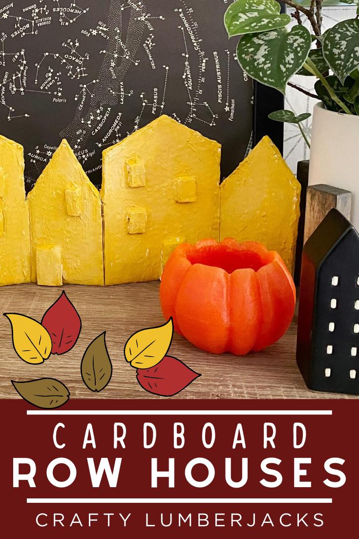 Create an autumn inspired set of row houses out of a cardboard box. #diy #upcycle #cardboard #autumndiy #falldiy #amazonpackage #amazoncardboard #zipsnip #worxtool #worx amazonbox #shippingbox #shippingboxupcycle #easycraft #cardboardideas #cardboardcraft #cardboarddiy #happyfall #falltablescape #autumntablescape #autumnideas #autumnglow #yellowhouse #spakle #organic #farmhousedecor #farmhouse #fallfarmhouse #thanksgivingdecor #thanksgivingtable #rowhouses #cityhouses #septembercarft #craftknife #tinyhouses #cutecrafts #upcycleideas #feelingfall #gather #fallleaves #falldecorations #fallhack #homedecor #homeideas #homedecorations #homehacks #fallhacks #fallspiration