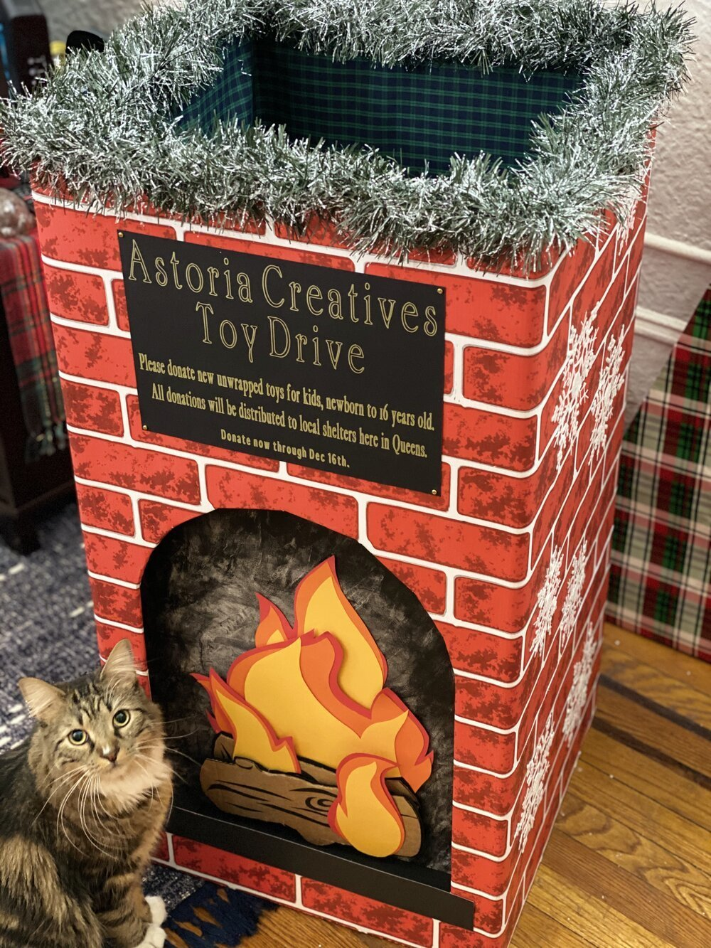 'Tis the season for giving! Turn a toy drive donation collection box into a vintage fireplace. Don't forget to give back this year!  #christmastoydrive #toydrive #vintagechristmas #gaycouple #astorianewyork #astoriaqueens #queens #christmasdonations #christmascardboardcrafts #toysfortots #charityevent #boxupdo #vintagefireplace