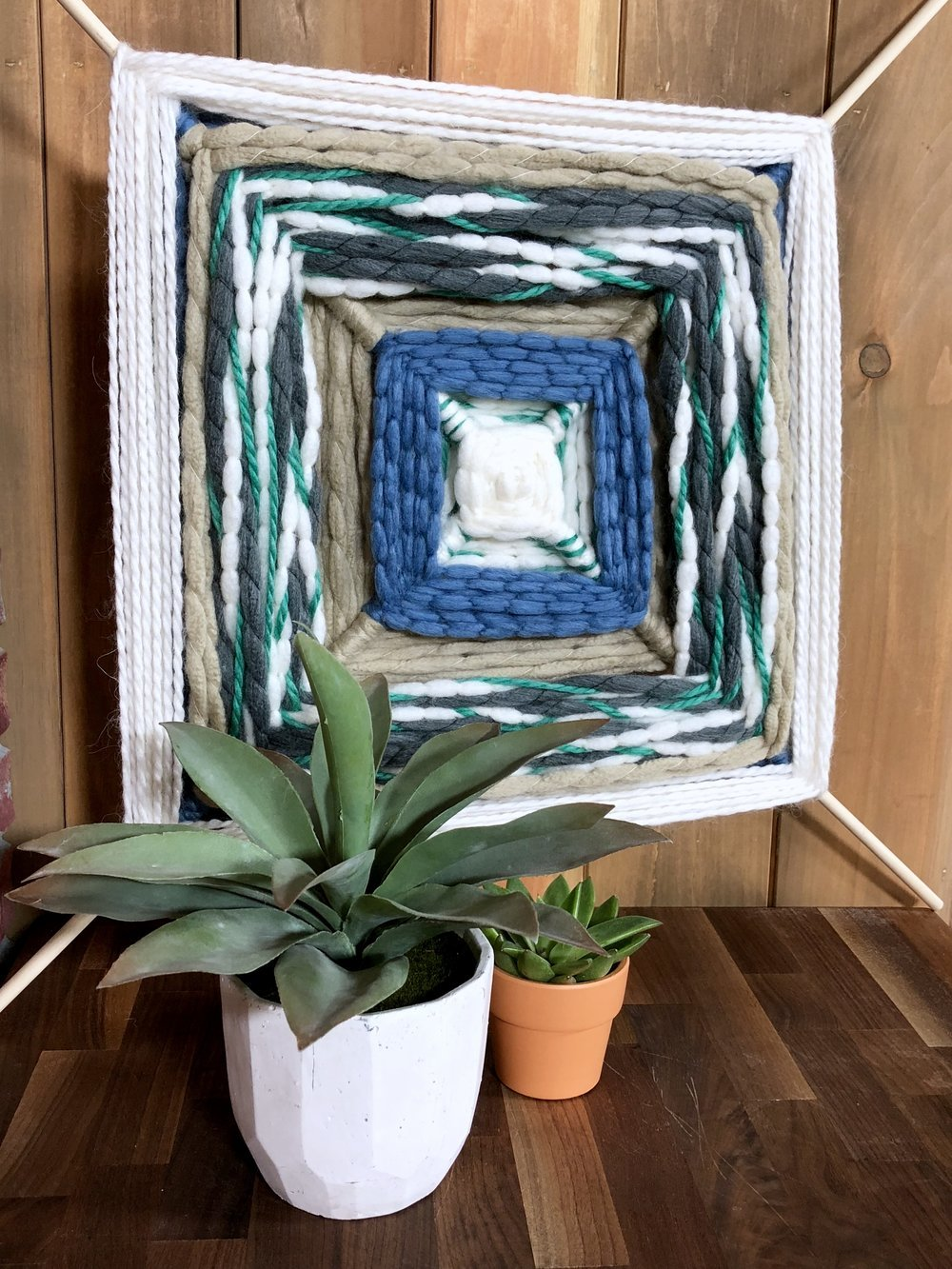 Throwback Summer Camp Crafts for Adults - We were inspired by old camp patches and got crafty with felt, made a larger than life God's eye with chunky yarn and turned a loopers finger weave into a basket up do!  #summerdiy #felt #chunkyyarn #campcrafts #summer #summerdiycrafts #summercampactivities #feltart #scenicart #camping #nature #throwback #godseye #loopers #homedecor #homedecorating #throwbackcrafts